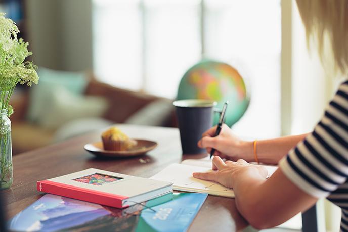 Professional Woman Writing on Desk